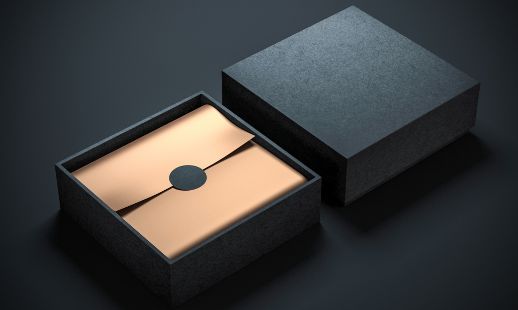 Two Square Black Boxes with golden wrapping paper