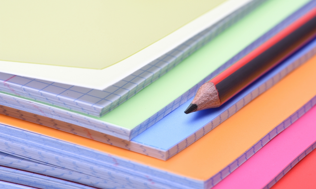 Multi Coloured Exercise Books and Pencil